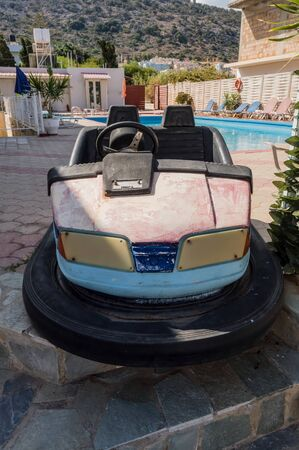 Scooter carnival car in front of a swimming pool in the city of Stalis in Crete Stock Photo