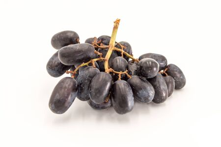Bunch of blue wet grapes isolated on white background