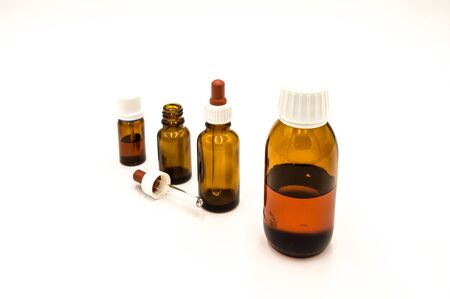 Four brown pharmacy bottles on a white background