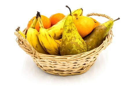 Healthy food. Organic fruits and vegetables, bananas, clementines, pears on a wooden background
