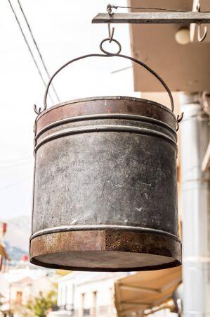 Scrap bucket hanging outside by a hook