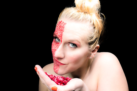 meets: Model meets pomegranate with a special MakeUp Stock Photo