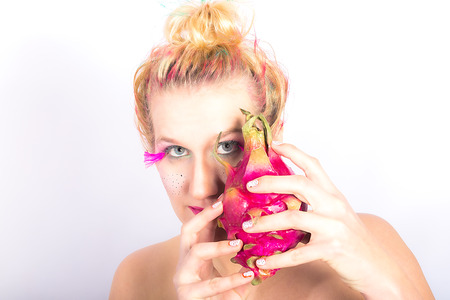 Models with a special MakeUp meets dragon fruit photo