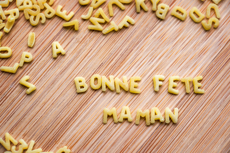 bonne: Pasta forming the text Bonne Fete Maman, meaning Happy Mothers Day in French