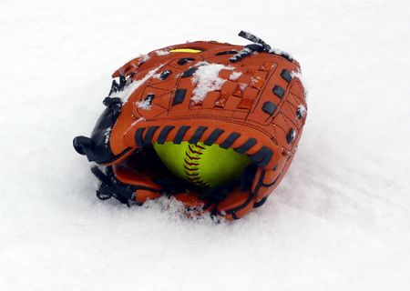 softball: Baseball glove and ball in the snow
