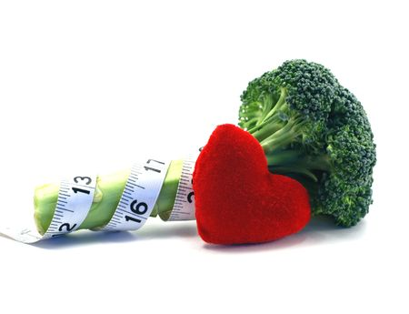 Fresh broccoli  heart and lifestyle concept over a white background