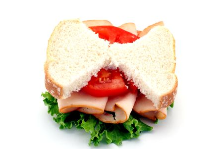 Low-carb diet concept with skinny bread slices on a turkey sandwich isolated over a white background