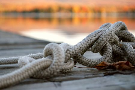 Close up of knotted rope on a dock in Autumn