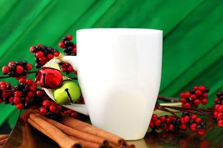 Blank white mug surrounded by holiday decoration
