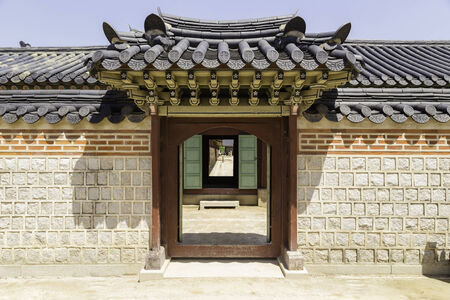 fortified wall: Gyeongbokgung Palace Fortified Wall and Carved Wooden Door in Seoul, South Korea Editorial
