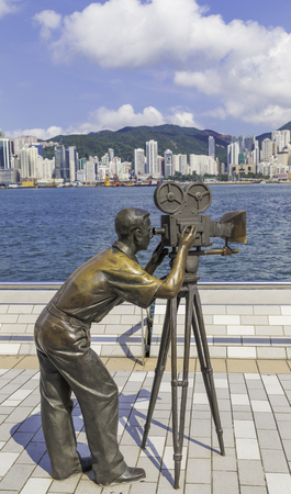 filming: The statue filming Hong Kong harbour.