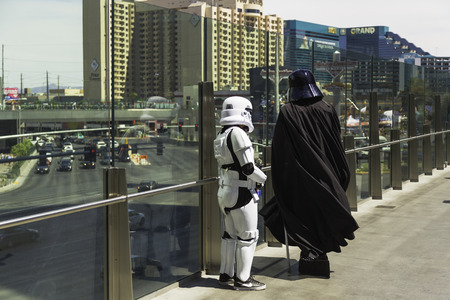 Darth Vader consulting with his storm trooper in Las Vegas. Editorial