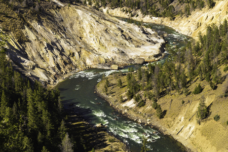 s curve: Yellowstone National Park, Wyoming, United States September 20, 2014 – A wicked S curve by one of the rivers running through Yellowstone Park.