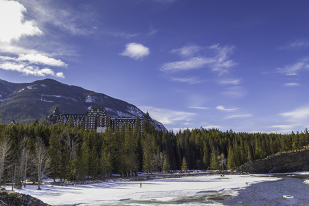 Banff Springs Hotel in the town of Banff set in the Rocky Mountains during winter. photo