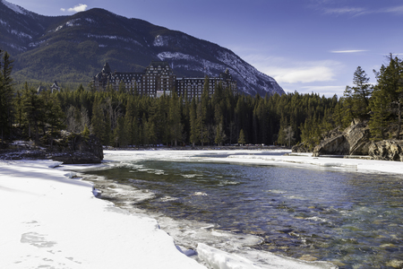 The Beautiful Banff Springs Hotel surrounded by the rocky mountains in winter. photo