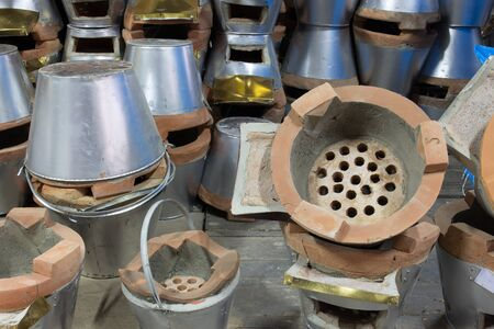 Charcoal burning clay stove in store