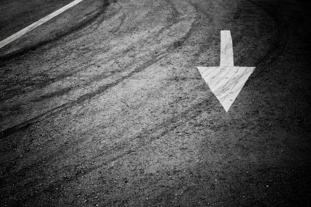 White arrow on the road  Stock Photo - 14120468