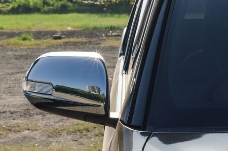 wing mirror of a car.Folding the side mirror while parking. Helps to ensure the safety of the device.
