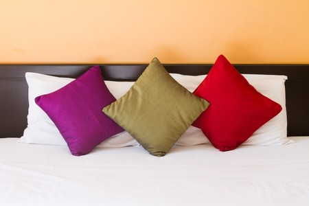 red pillows: pillows in three colors Stock Photo