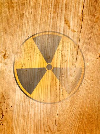 Radiation symbol on old wood Stock Photo - 9096431