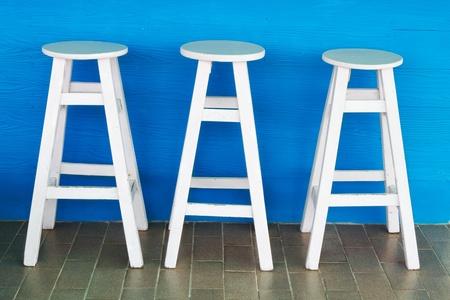 Round, white wooden chairs