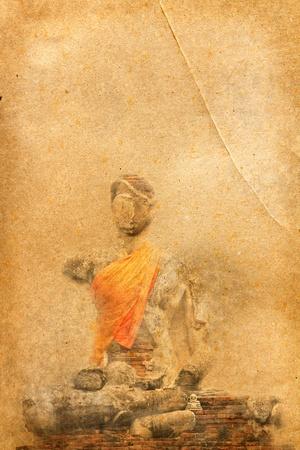 Buddha statue on old paper  photo
