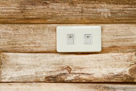 Socket on the wood wall photo