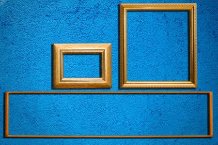 The frame on the blue wall Stock Photo - 10347630