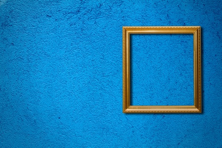 The frame on the blue wall Stock Photo - 10347633