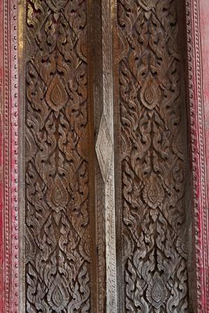wood carving door: Pattern wooden on door temple  Stock Photo