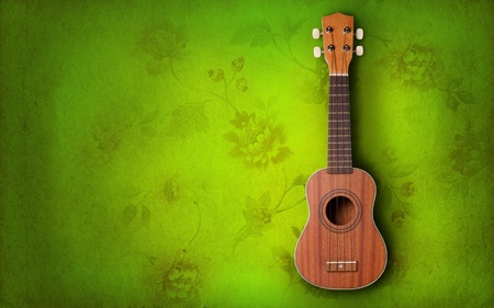 Ukulele on green background photo
