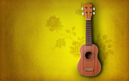 Ukulele on yellow background photo