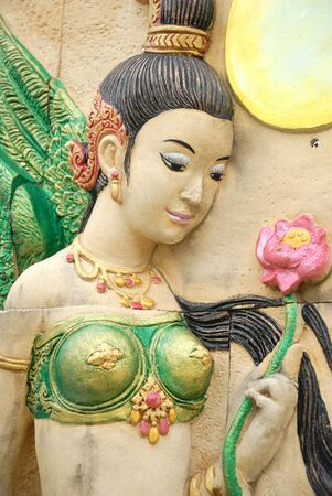 Ancient Thai Fairy angel sculpture in the temple of Thailand photo