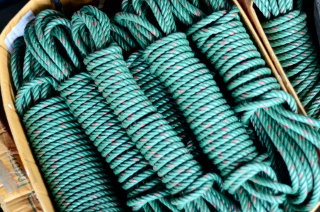 Big roll of green nylon cable rope  photo