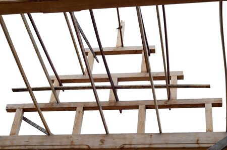 Bracing teak wood roof frame structure between construction on isolate white background Stock Photo - 21503026