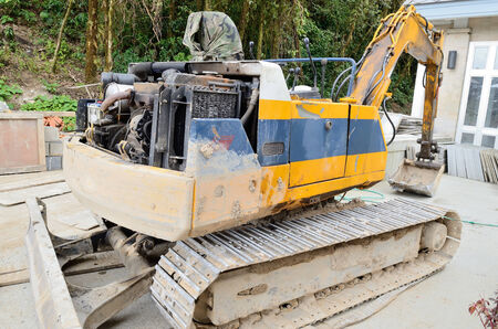 Wheel loader Excavator unload moving works at construction site  photo