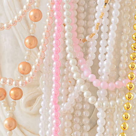 Close up detail view of a woman long pearl necklace Stock Photo - 24038835