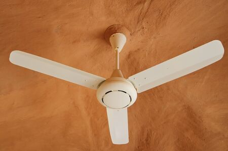 ceiling fan: Ceiling fan is connection with EARTHEN HOUSE Stock Photo