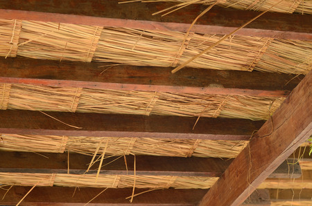 wood rafter and local roof made from dry leaves in Thailand country photo