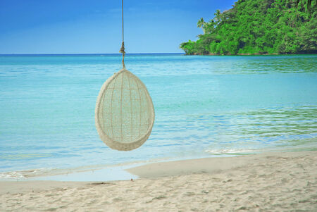 Decorate swing hang on tree at the beach photo