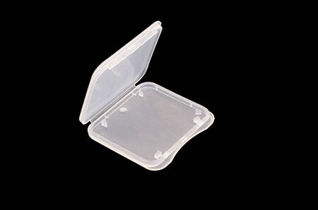 SD memory card plastic case in isolate black photo