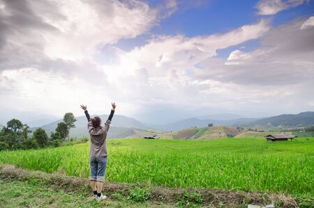 Asia woman stand under the sky and breath ozone in the air Stock Photo
