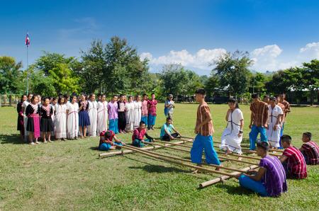 joe louis: CHIANGMAI,THAILAND-NOV21:Lao Kratop Mai or Ti wha This amusement is bamboo clapping with folk dance play of Thai Lanna People , 21 November 2014