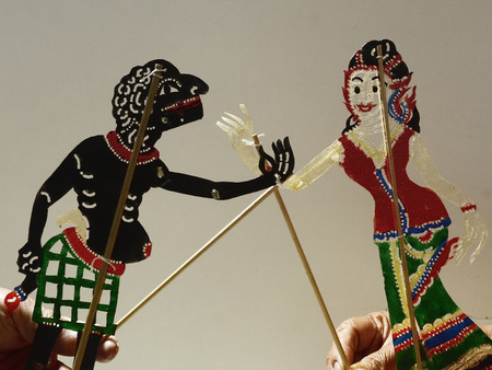 narratives: Nang Ta Lung Shadow Play .The cowhide puppets in front of white screen with music and narratives