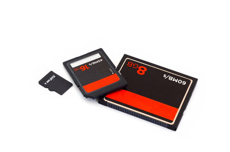 digital memory: SD card ,CF Card ,Compact flash card and micro SD card isolate on white