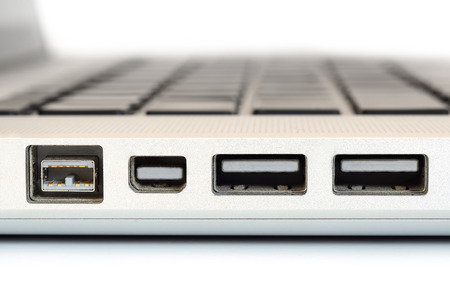 Show sideview closeup up of computer laptop selective focus on firewire port photo