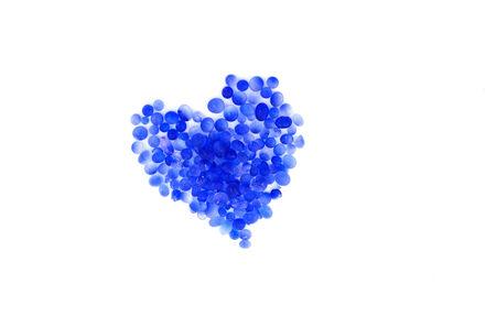silica: blue silica gel heart shape ,moisture adsorbing on white background