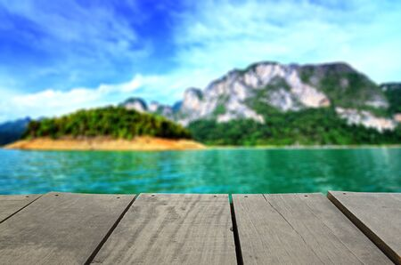 cayak: Defocused and blur image of terrace wood and beautiful seascape for background usage