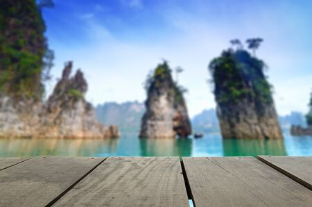 cayak: Defocused and blur image of terrace wood and beautiful Jetty walkway into the sea at Thailand for background usage Stock Photo