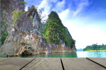 cayak: Defocused and blur image of terrace wood and beautiful Jetty walkway Guilin Thailand at suratthanee for background usage